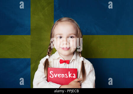 Swedish concept with little girl student with book against the Sweden flag background. Learn swedish language - Stock Photo