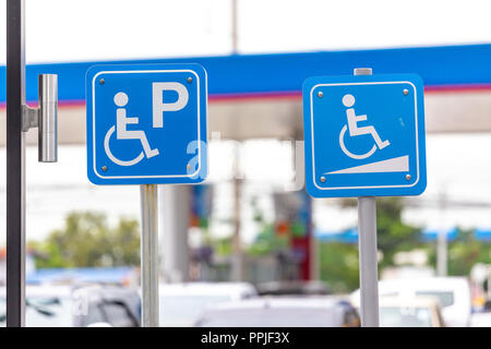 Parking for disabled guests label in gas station. - Stock Photo