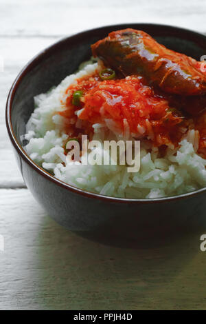 Rice with tomato sauce Top view and empty space. - Stock Photo