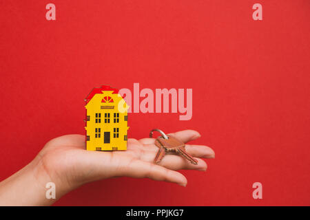 the symbol of the house and the keys in the palm of your hand. - Stock Photo