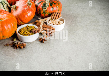 Set of homemade pumpkin spice, various ingredients for pumpkin pie, cookies and coffee latte - Stock Photo