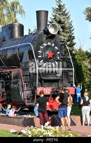Voronezh, Russia - August 23. 2018. Monument to the locomotive of the E series in the park at the railway station - Stock Photo