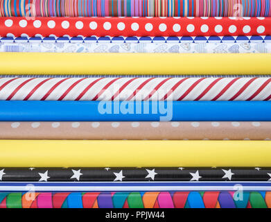 Colorful paper for wrapping gifts. Preparing for a holiday. - Stock Photo
