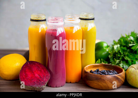 Fresh smoothies in bottles , colorful healthy organic smoothies with fruits and vegetables - Stock Photo