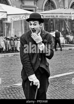 Italy, Rome, March 8/ 2018, Mime dressed as Charlie Chaplin in Piazza Navona (Navona Square) - Stock Photo