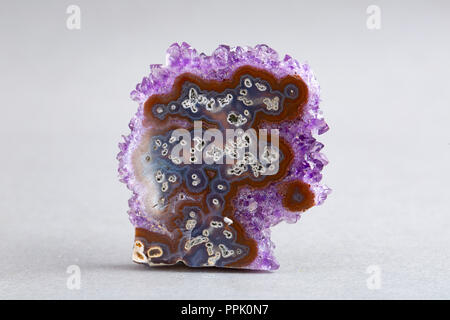 Natural Druse of amethyst on a white background stone - Stock Photo
