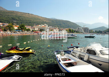 Small boat harbor in Petrovac, Montenegro, Europe. Beach with hotels in the background. Horizontal photo with copy space. - Stock Photo