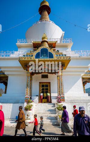 Pilgrims circle the National Memorial Chorten in Thimpu, the capital city of the Himalayan Kingdom of Bhutan - Stock Photo