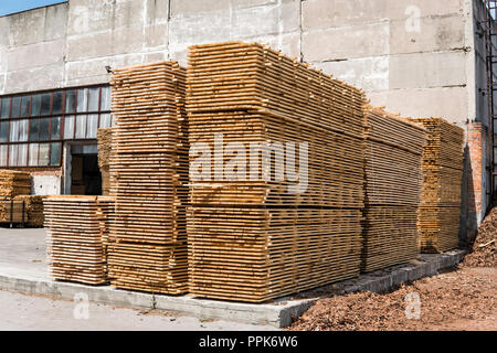 Piles of wooden boards in the sawmill, planking. Warehouse for sawing boards on a sawmill outdoors. Wood timber stack of wooden blanks construction material. Industry. - Stock Photo