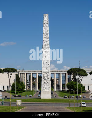 Rome. Italy. EUR. The obelisk dedicated to Guglielmo Marconi on the Piazza Guglielmo Marconi.  The 45 metre high obelisk made with reinforced concrete - Stock Photo