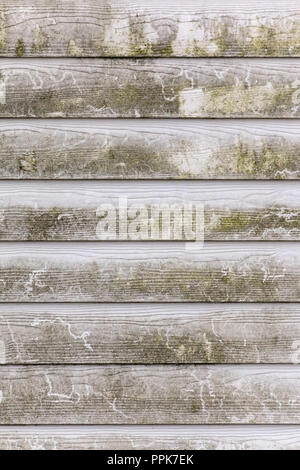 Background image featuring a weathered wooden plank wall. - Stock Photo