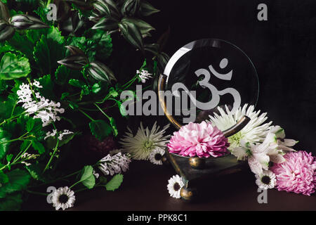 Pink Mum on Om Altar with Mixed Flowers and Foliage - Stock Photo