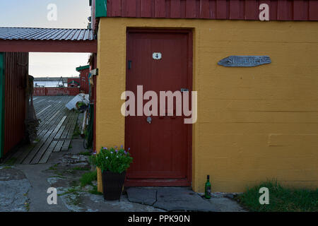 Restored Fishermen's Shacks (Rorbuer or Rorbu), Painted In The Traditional Falun Red (Falu Red), In The Fishing Village Of Stamsund, Norway. - Stock Photo
