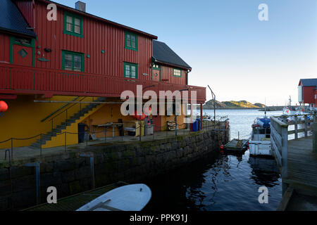Restored Fishermen's Shacks (Rorbuer or Rorbu), Painted In The Traditional Falun Red (Falu Red), In The Fishing Village Of Stamsund, Lofoten Islands. - Stock Photo