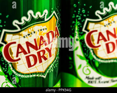 Cans of Canada Dry Ginger Ale. John J. McLaughlin formulated his Ginger Ale to be less sweet than others and as a result, he labeled it dry. - Stock Photo