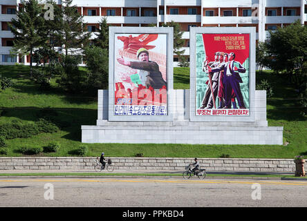Huge propaganda murals in Pyongyang which are produced at Mansudae Art Studio - Stock Photo