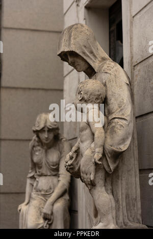 Monument of a sad mother saying goodbye to her baby taken by death - Stock Photo
