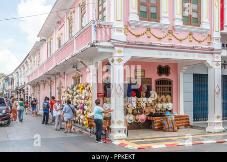 Phuket, Thailand - 2nd September 2018: tourists and hat stall, Thalang Road at junction with Soi Rommanee. Many tourists come to visit. - Stock Photo