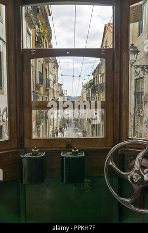 LISBON, PORTUGAL - September 03, 2018: A view from the cockpit of Bica Funicular also known as Ascensor da Bica or Elevador da Bica on Rua Da Bica - Stock Photo