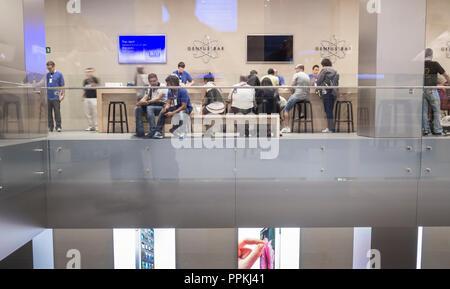 Customer support Genius Bar in Apple store in Barcelona, Spain - Stock Photo