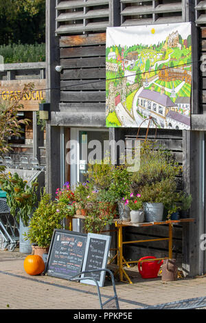 Shop signs and produce including pumpkins at the entrance to Harwarden Estate Farm Shop, Flintshire, Wales - Stock Photo