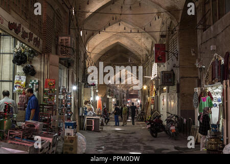 ISFAHAN, IRAN - AUGUST 7, 2018: Street of the Isfahan bazar in the evening in a covered alley of the market. Symbol of the Persian architecture, it's  - Stock Photo