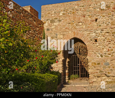 Gate in a fortified wall Alcazaba moorish castle in Malaga - Stock Photo