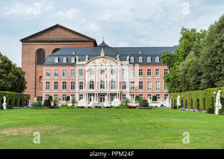 The Electoral Palace in Trier in Germany directly next to the Basilika is considered one of the most beautiful rococo palaces in the world.  - Stock Photo