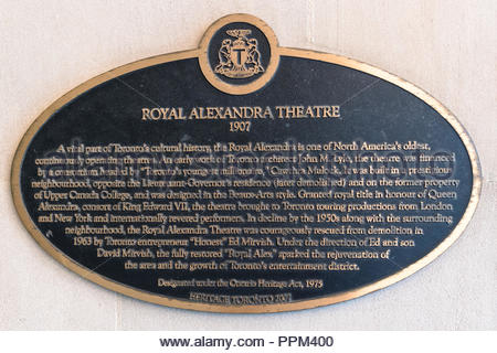 Royal Alexandra Theatre historic plaque. The old building is a tourist attraction in the downtown district of the Canadian city - Stock Photo