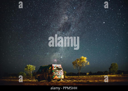 Graffitied Camper van and the milky way, South Australia. - Stock Photo