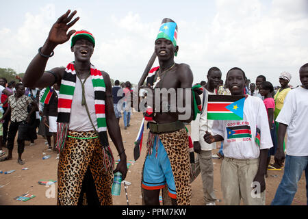 Saturday 9 july 2011 – Juba, Republic of South Sudan – South Sudanese boys wave the flag of their new country and dance during South Sudan's independence day celebrations in Juba. Tens of thousands of citizens of the new South Sudan celebrate national independence but whether statehood will resolve issues of identity after a decades-long war remains to be seen. Photo credit: Benedicte Desrus - Stock Photo
