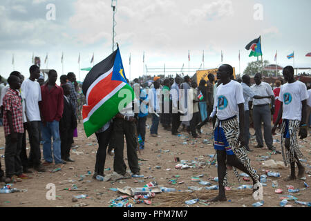 Saturday 9 july 2011 – Juba, Republic of South Sudan – South Sudanese hold the flag of their new country during South Sudan's independence day celebrations in Juba. Tens of thousands of citizens of the new South Sudan celebrate national independence but whether statehood will resolve issues of identity after a decades-long war remains to be seen. Photo credit: Benedicte Desrus - Stock Photo