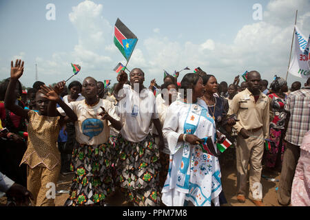 Saturday 9 july 2011 – Juba, Republic of South Sudan – South Sudanese hold the flag of their new country and dance during South Sudan's independence day celebrations in Juba. Tens of thousands of citizens of the new South Sudan celebrate national independence but whether statehood will resolve issues of identity after a decades-long war remains to be seen. Photo credit: Benedicte Desrus - Stock Photo
