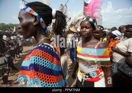 Saturday 9 july 2011 – Juba, Republic of South Sudan – South Sudanese traditional dancers  wave the flag of their new country and dance during South Sudan's independence day celebrations in Juba. Tens of thousands of citizens of the new South Sudan celebrate national independence but whether statehood will resolve issues of identity after a decades-long war remains to be seen. Photo credit: Benedicte Desrus - Stock Photo