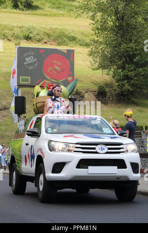 The white Carrefour cars throwing free gifts during the 2018 Tour de France 17th stage in Soulan, French Pyrenees, ans supporters on the roadside. - Stock Photo