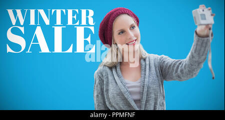 Composite image of woman taking selfie - Stock Photo