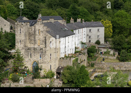 Arkwright's Apprentice House, an 18th century building, adjacent to Cressbrook Mill, viewed from the Monsal Trail; Derbyshire, UK - Stock Photo