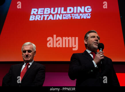 Liverpool, UK. 26th Sep 2018. Shadow Secretary of State for International Trade, Barry Gardiner, starts 'The Red Flag' by whistling to the delegates at the Labour Party Conference in Liverpool. Credit: Mark Thomas/Alamy Live News - Stock Photo