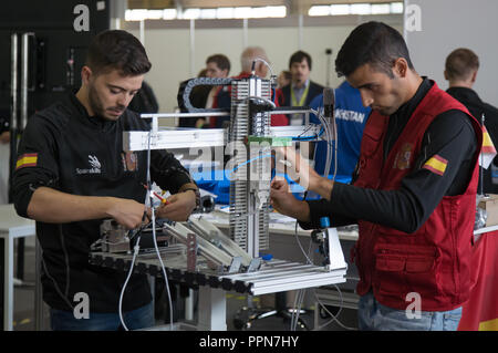 Budapest. 26th Sep, 2018. Participants compete in mobile robotics during the EuroSkills Championship in Budapest, Hungary on Sept. 26, 2018. EuroSkills is a European Championship for young professionals to promote and showcase their skills. It is the European regional version of WorldSkills Competition, formerly known as 'Skills Olympics'. Credit: Attila Volgyi/Xinhua/Alamy Live News - Stock Photo