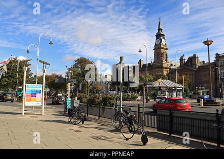 Bicycle's are secured to a bike stand's on the wide pavement of Lord Street in Southport on the other side of the road from the Atkinson art gallery. - Stock Photo