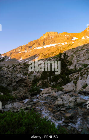 Sunrise along the King River with the Black Divide in the background. John Muir Trail/Pacific Crest Trail; Sequoia Kings Canyon Wilderness; Kings Cany - Stock Photo