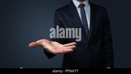 Businessman without head holding something without theme - Stock Photo