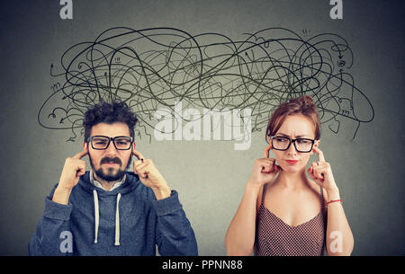 Angry displeased couple woman and man ignoring not listening each other exchanging with many negative thoughts - Stock Photo