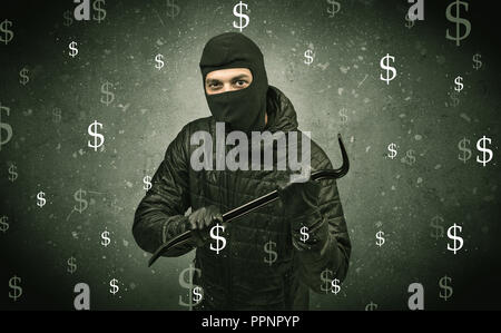 Money hungry thief in black clothes and tolls on his hand. - Stock Photo