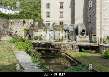 Restored turbine machinery at Cressbrook Mill, an old 19th century cotton mill now restored for residential use; Derbyshire, UK - Stock Photo