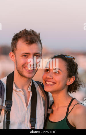 Young woman and young man look into the camera, couple, Plaza de la Encarnacion, Sevilla, Andalusia, Spain - Stock Photo