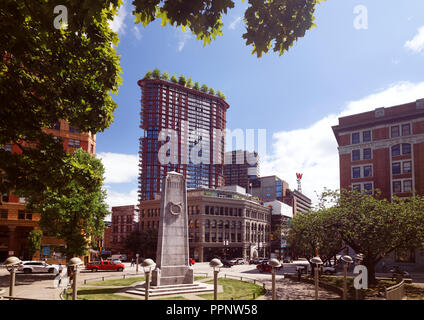 Woodward's Building with trees on top of the roof, Victory square, Downtown Eastside, Vancouver, British Columbia, Canada - Stock Photo