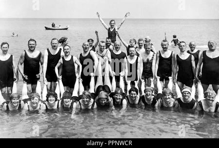Couple, funny bath group, the men hold their women by the legs, 1920s, Rügen, Baltic Sea, Germany - Stock Photo