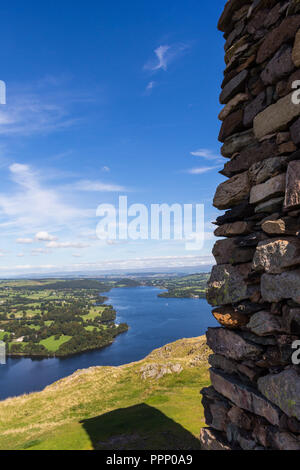 Beside the large stone cairn on the summit of Hallin Fell overlooking Ullswater in the Lake District, England. - Stock Photo