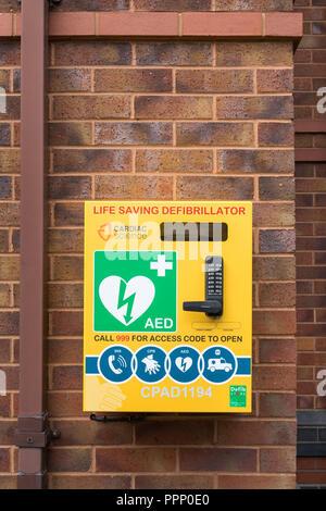 AED Life saving defibrillator in public place, UK - Stock Photo